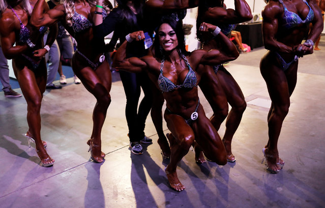 Competitors pose backstage during the Arnold Classic South America bodybuilding event in Sao Paulo, Brazil, April 22, 2017. (Photo by Nacho Doce/Reuters)