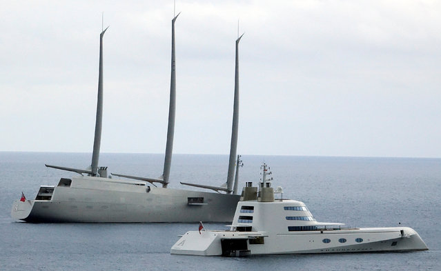 """The 142.81 metre sail-assisted motor yacht """"Sailing Yacht A"""" (L) and Super yacht """"Motor Yacht A"""", both owned by Russian tycoon Andrey Melnichenko, are seen in front of the Monaco harbour, May 4, 2017. A pair of superyachts worth a combined total of £600million took to the high seas together today. The £360million ($467,3million) """"Sailing Yacht A"""" was joined by the £240million ($311,5million) vessel """"Motor Yacht A"""" in Monaco, the playground of the rich on the French Riviera. Billionaire Andrey Melnichenko's Sailing Yacht A is among the largest in the world – measuring an epic 330ft (100,5m) high and 470ft (143,2m) long. The huge luxury yacht is manned by Merchant Navy trained sailors and is as big as a medium sized cargo ship. It has eight decks, a helicopter pad, an underwater observation room and a hybrid diesel-electric propulsion system. (Photo by Stefano Rellandini/Reuters)"""