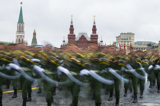 Russian soldiers march along Red Square during the Victory Day military parade in Moscow, Russia, on Tuesday, May 9, 2017. Victory Day is Russia's most important secular holiday, commemorating the Red Army's determination and losses in World War II. (Photo by Alexander Zemlianichenko/AP Photo)