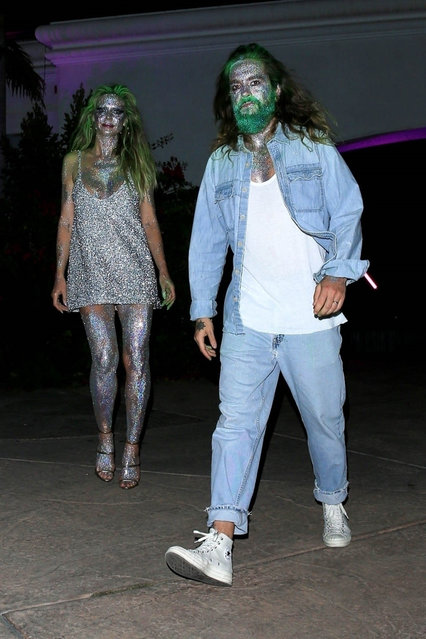 Model and TV Personality, Heidi Klum and Husband Tom Kaulitz go all out with silver metallic face paint and green hair dye for Paris Hilton's Halloween Party in Beverly Hills, CA. on October 24, 2019. (Photo by Backgrid USA)