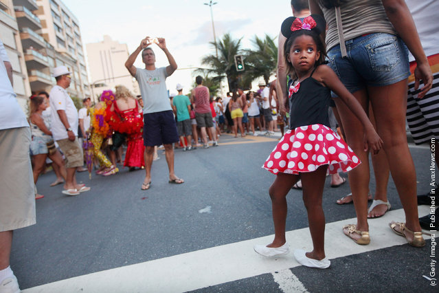 Brazilian revelers gather during Carnival celebrations along Ipanema beach in Rio de Janiero