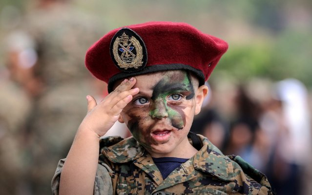 """Lebanese citizens attend a festival for the Lebanese army under the name """"A Day with the Homeland"""" at the Jounieh International Festivals in Jounieh, north of Beirut, 06 July 2019, where soldiers of the guerrilla forces carried out military maneuvers and shows as well as some military equipment. The audience participated with the army, where they dressed their children military uniforms and painted their faces with military colors. (Photo by Nabil Mounzer/EPA/EFE/Rex Features/Shutterstock)"""