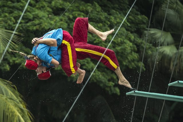 Divers for Hi-Dive show perform a jump from a springboard during a media preview of a new attraction at Sunway Lagoon theme park in Selangor, Malaysia, 20 May 2014. The show runs until 03 August 2014. (Photo by Ahmad Yusni/EPA)