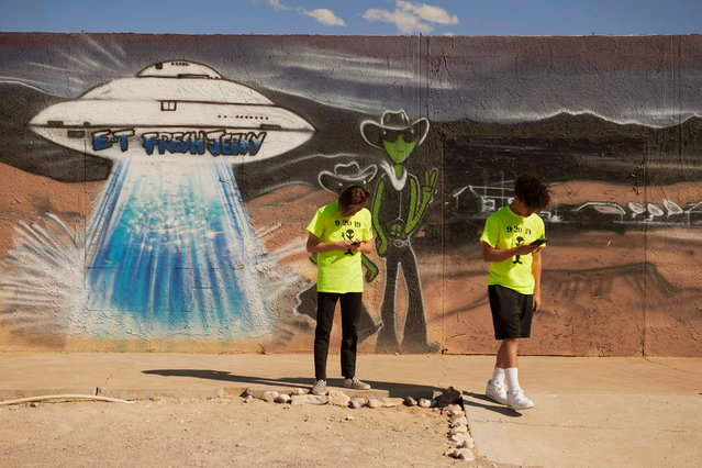 """Visitors stop to take photos at E.T. Fresh Jerky in Hiko, Nevada, on September 19, 2019. A joke Facebook event named """"Storm Area 51, They Can't Stop All of Us"""", was created in June 2019. As of September 13, more than 2 million people had signed up for the event and a 1.5 million more had marked themselves as """"interested"""". Multiple alien related events are now set to take place over the weekend of September 20, 2019 along state Route 375 also known as the """"Extraterrestrial Highway"""". (Photo by Bridget Bennett/AFP Photo)"""