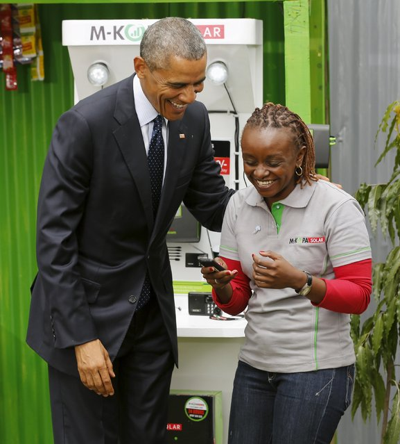 U.S. President Barack Obama (L) talks with a solar power businessperson at the Power Africa Innovation Fair at the United Nations compound in Nairobi, Kenya July 25, 2015. (Photo by Jonathan Ernst/Reuters)