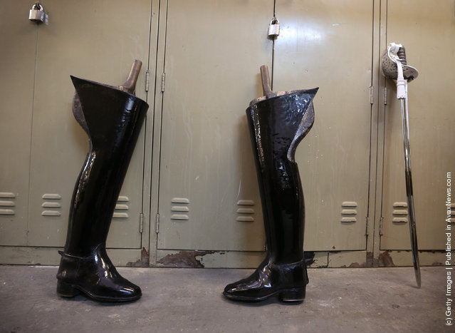 Riding boots and a ceremonial sword await cleaning at The Household Cavalry Mounted Regiment (HCMR)  Hyde Park Barracks