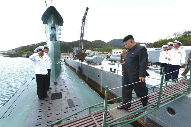 North Korean leader Kim Jong Un (C) boards a submarine during his inspection of the Korean People's Army (KPA) Naval Unit 167 in this undated photo released by North Korea's Korean Central News Agency (KCNA) in Pyongyang June 16, 2014. (Photo by Reuters/KCNA)