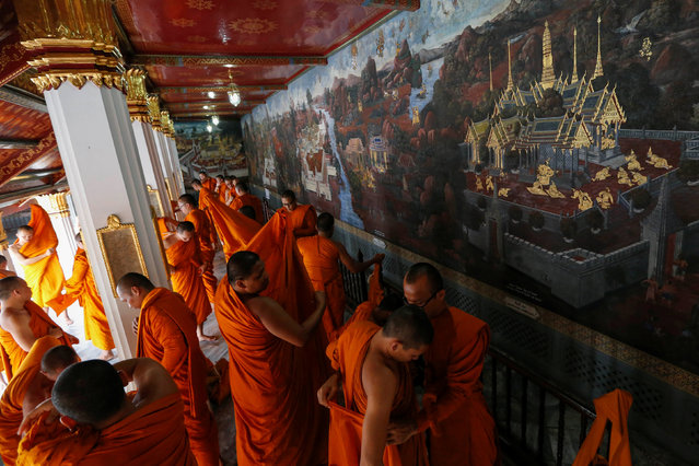 Buddhist monks get ready for a ceremony at the Grand Palace to commemorate Thailand's King Bhumibol Adulyadej's 70th anniversary on the throne, in Bangkok, Thailand June 9, 2016. (Photo by Jorge Silva/Reuters)