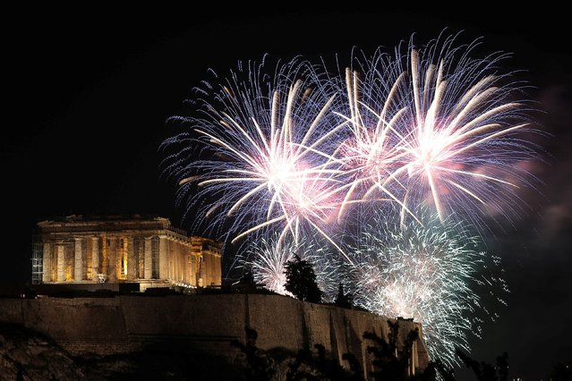 Fireworks explode over the ancient Parthenon temple atop the Acropolis hill during New Year's day celebrations in Athens, Greece on January 1, 2020. (Photo by Costas Baltas/Reuters)