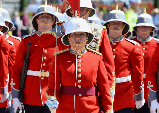 Captain Megan Couto (C) of the 2nd Battalion, Princess Patricia's Canadian Light Infantry (PPCLI) leads her battalion to makes history as the first woman to command the Queen's Guard at Buckingham Palace in central London on June 26, 2017. (Photo by John Stillwell/AFP Photo)
