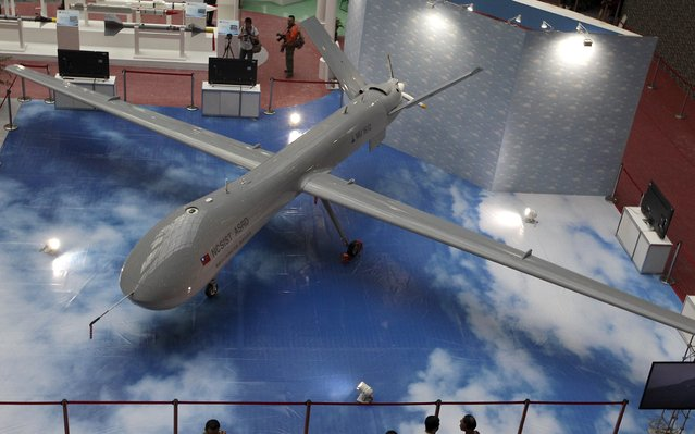 A Taiwan-made MALE (medium-altitude long-endurance) unmanned aircraft is displayed at the Taipei World Trade Centre during the 2015 Taipei Aerospace and Defense Technology Exhibition, August 12, 2015. The Taipei Aerospace and Defense Technology Exhibition is held from August 13 to 16. (Photo by Pichi Chuang/Reuters)