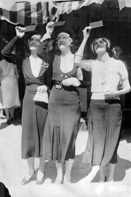 Watching Old Sol thru rose-colored glasses were these three pretty girls The Post's cameraman found on Sixteenth street at the time of the partial eclipse in 1932. A lot of people were looking at the sun at the same time but it was difficult for them to keep their eyes skyward with the girls nearby. Left to right: Leona Lindsay, Marian Lindsay and Claribel Givler. (Photo by Denver Post/Library archive)