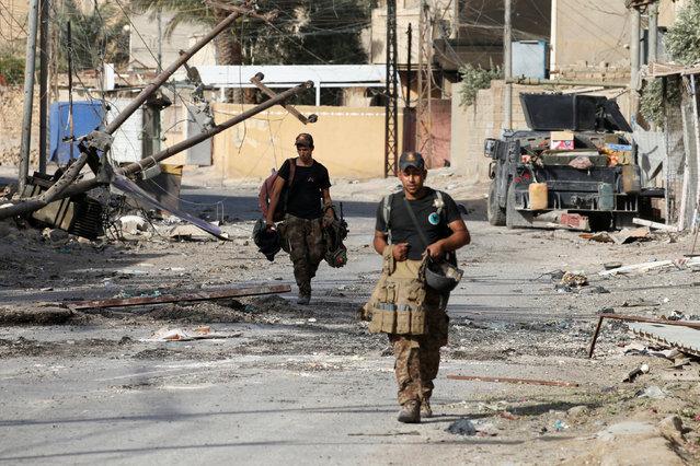 Iraqi counterterrorism forces walk in Falluja, Iraq, June 26, 2016. (Photo by Thaier Al-Sudani/Reuters)
