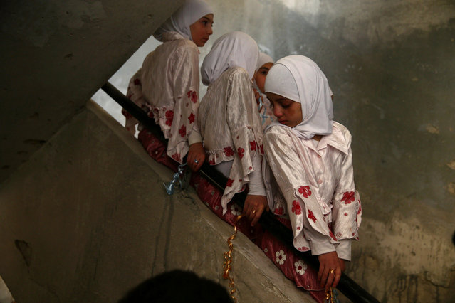 Girls wait in line during a celebration marking the end of the school year in the town of Douma, eastern Ghouta in Damascus, Syria May 21, 2016. (Photo by Bassam Khabieh/Reuters)