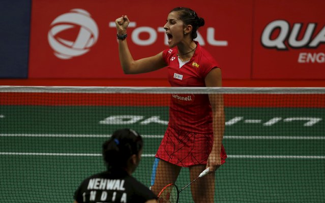 Spain's Carolina Marin reacts during her women's finals badminton match against India's Saina Nehwal at the BWF World Championships in Jakarta, August 16, 2015. (Photo by Reuters/Beawiharta)