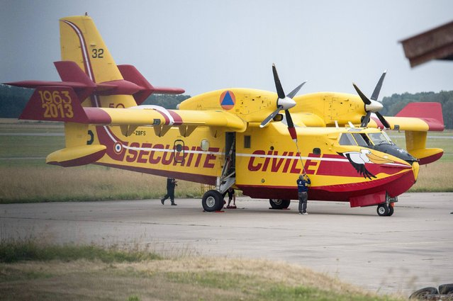 A Canadair CL-415 SuperScooper waterbomber, one of two lent by the French Civil Security, is pictured after landing at Vasteras airport August 5, 2014. The aircraft, purpose-built to dump its cargo of over 6 tons of water onto a fire, will assist in putting out the wildfire that rages through thousands of hectares in Central Sweden. (Photo by Fredrik Sandberg/Reuters/TT News Agency)