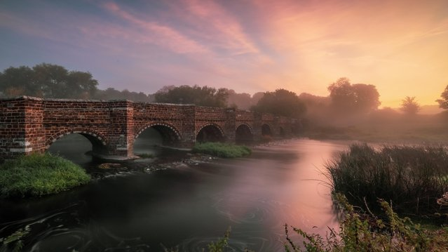 Sunrise over the Stour at White Mill in Sturminster Marshall, Dorset, England on September 13, 2019. The bridge dates to the 16th century, although its timber pilings are 400 years older. (Photo by Matt Pinner/BNPS Press Agency)