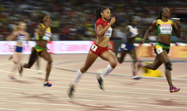 Allyson Felix of the U.S. (C) competes in her women's 400 metres semi-final at the 15th IAAF World Championships at the National Stadium in Beijing, China August 25, 2015. (Photo by Dylan Martinez/Reuters)