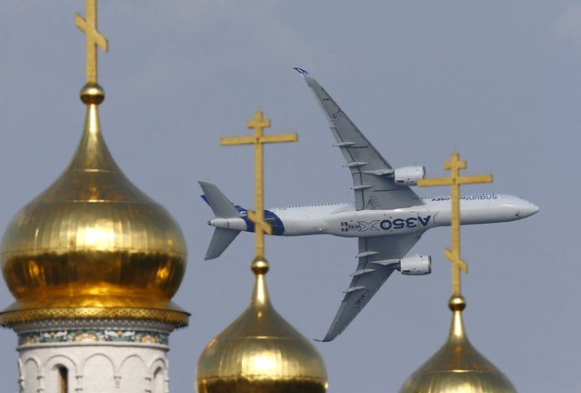 An Airbus A350 XWB aircraft flies over the domes of an Orthodox church during the MAKS International Aviation and Space Salon in Zhukovsky, outside Moscow, Russia, August 26, 2015. (Photo by Maxim Zmeyev/Reuters)