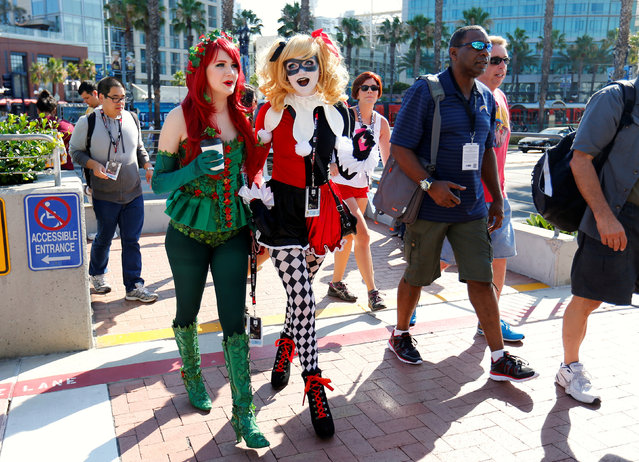Attendees dressed as Poison Ivy and Harley Quinn arrive for opening day of the annual Comic-Con International in San Diego, California, United States July 21, 2016. (Photo by Mike Blake/Reuters)