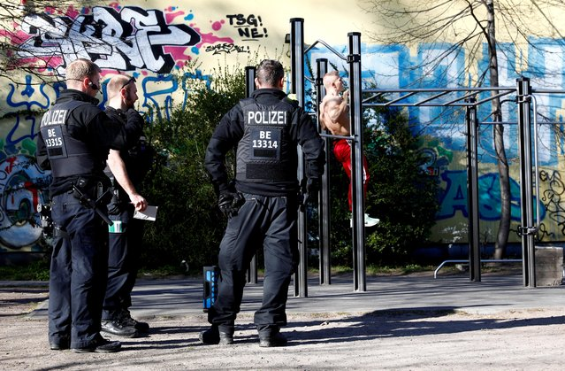Police officers patrol in Boeckler park in Kreuzberg district, during the coronavirus disease (COVID-19) outbreak, in Berlin, Germany, April 4, 2020. (Photo by Michele Tantussi/Reuters)