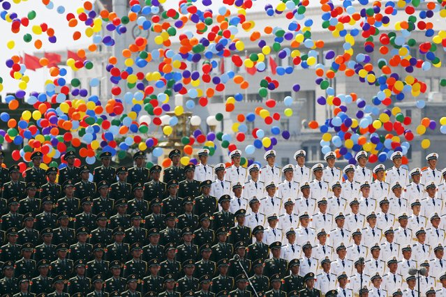 Colourful balloons are released at the end of the military parade marking the 70th anniversary of the end of World War Two, in Beijing, China, September 3, 2015. (Photo by Damir Sagolj/Reuters)