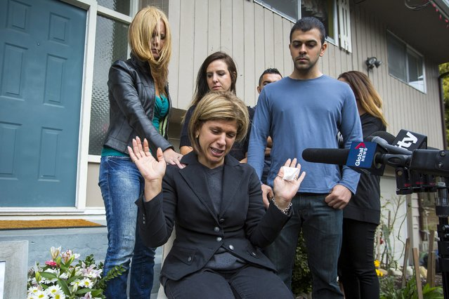 Tima Kurdi, sister of Syrian refugee Abdullah Kurdi whose sons Aylan and Galip and wife Rehan were among 12 people who drowned in Turkey trying to reach Greece, cries while speaking to the media outside her home with friends and family behind her in Coquitlam, British Columbia September 3, 2015. (Photo by Ben Nelms/Reuters)