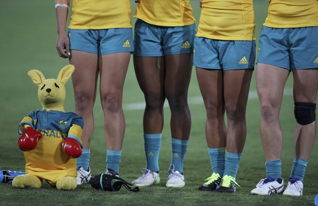 A toy kangaroo stands next to the Australian players as they sing their national anthem before the women's gold medal field hockey match against New Zealand, August 8, 2016. Australia won, 2-1. (Photo by Phil Noble/Reuters)
