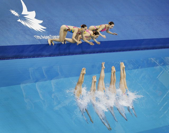 Bronze medallists of North Korea perform in the Teams Free Routine synchronised swimming final at Munhak Park Tae-hwan Aquatics Center during the 17th Asian Games in Incheon September 22, 2014. (Photo by Tim Wimborne/Reuters)
