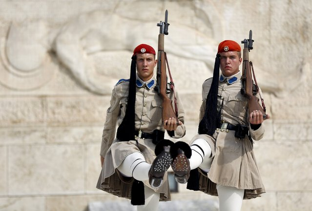 Greek presidential guards perform a ceremonial march at the Tomb of the Unknown Soldier in front of the parliament building in Athens, Greece, September 12, 2015. The leftist Syriza party of former Greek prime minister Alexis Tsipras maintained a wafer-thin pre-election lead over conservative New Democracy in three opinion polls on Saturday, with a fourth putting them level-pegging, ahead of the general elections to be held September 20. (Photo by Paul Hanna/Reuters)