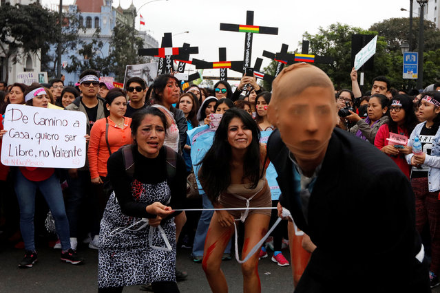 People take part in a protest against violence against women in Lima, August 13, 2016. (Photo by Guadalupe Pardo/Reuters)