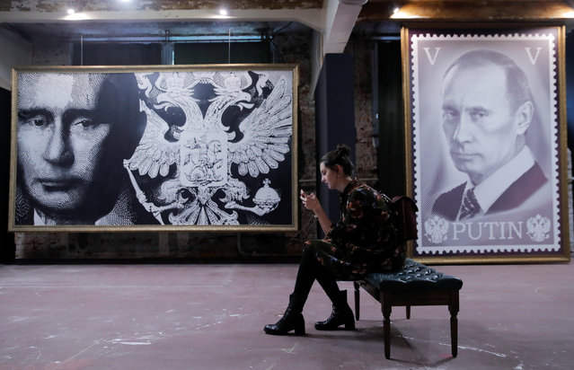"""A woman sits on a bench at the """"SUPERPUTIN"""" exhibition at UMAM museum in Moscow, Russia on December 6, 2017. (Photo by Maxim Shemetov/Reuters)"""
