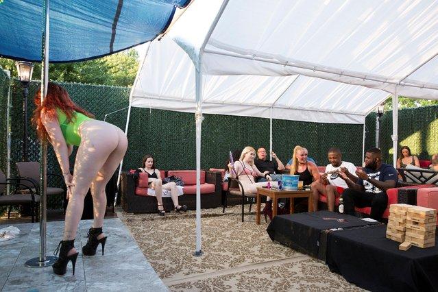 Dancers perform on the outside patio at Cheerleaders Gentlemen's Club in Gloucester City, New Jersey, U.S. on July 17, 2020. (Photo by Rachel Wisniewski/Reuters)