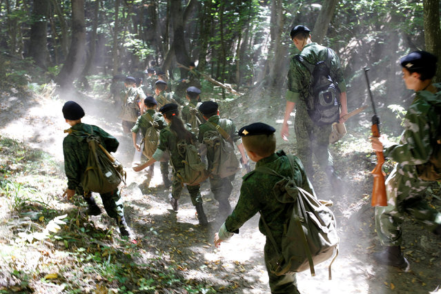 Fifth-grade students of the General Yermolov Cadet School, instructed by tenth-graders and schoolmasters, march during their first military tactical exercise on the ground, which includes radiation resistance classes, forest survival studies and other activities, in Stavropol, Russia, September 10, 2016. (Photo by Eduard Korniyenko/Reuters)