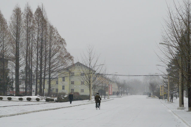 The empty snow-covered streets of the capital in February 2013, in Pyongyang, North Korea. (Photo by Andrew Macleod/Barcroft Media)