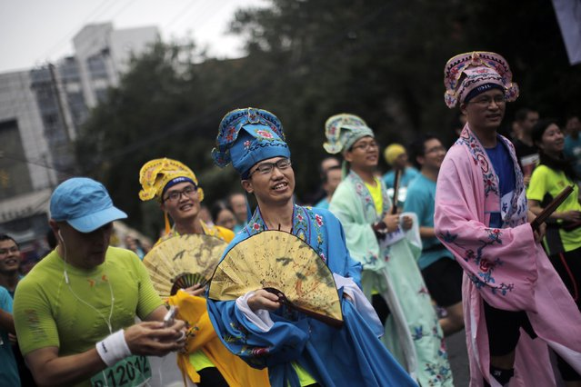 Participants, in fancy dress, while competing in the Shanghai International Marathon November 2, 2014. (Photo by Carlos Barria/Reuters)