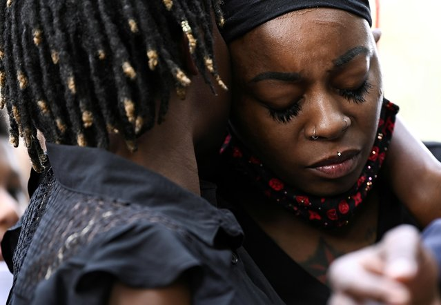 Letetra Wideman and Zanetia Blake, sisters of Jacob Blake, a Black man who was shot several times in the back by a police officer, embrace during a news conference outside the Kenosha County Courthouse in Kenosha, Wisconsin, U.S. August 25, 2020. (Photo by Stephen Maturen/Reuters)