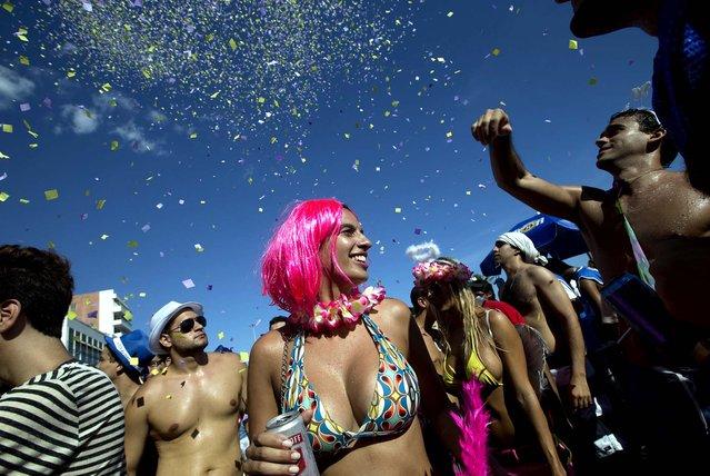 Confetti rains down on a group of revelers at the Simpatia e Quase Amor block party in Rio. (Photo by Silvia Izquierdo/Associated Press)