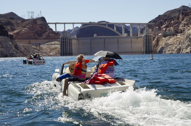 A 1965 Amphicar driven by Dean Baker of Lake Havasu, Arizona heads toward Hoover Dam during the first Las Vegas Amphicar Swim-in at Lake Mead near Las Vegas, Nevada October 9, 2015. (Photo by Steve Marcus/Reuters)