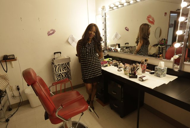 Former Cuban rafter Moraima Alfonso, 51, poses in the America TV dressing room where she works as a makeup artist in Miami, September 17, 2014. Alfonso said she spent ten days at sea and was suffering hallucinations when she was picked up by the U.S. Coast Guard in 1994. (Photo by Rolando Pujol Rodriguez/Reuters)