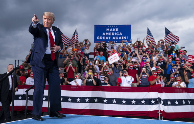 President Donald Trump arrives to speak at a campaign rally at Smith Reynolds Airport, Tuesday, September 8, 2020, in Winston-Salem, N.C. (Photo by Evan Vucci/AP Photo)