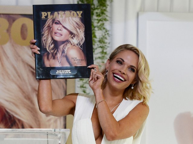Dani Mathers, 28, the 2015 Playmate of the Year, holds a plaque with the cover of the Playboy June 2015 issue at the Playboy Mansion in Los Angeles, California in this file photo taken May 14, 2015. Playboy has decided to stop publishing picture of nude women, according to an article in the New York Times. (Photo by Kevork Djansezian/Reuters)