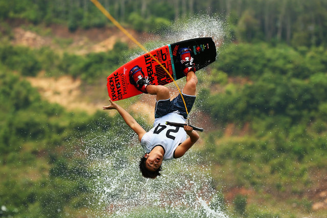 Yasui Toshiki of Japan competes in the semi-final of the Men's Wakeboard during the 2014 Asian Beach Games at Bangneow Dam on November 20, 2014 in Phuket, Thailand. (Photo by Cameron Spencer/Getty Images)