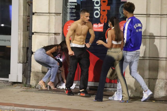 People out for the evening in Manchester, one man without a top on October 11, 2020, ahead of a possible government announcement on Monday. (Photo by Danny Lawson/PA Images via Getty Images)