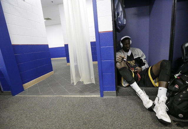 Wichita State's Ehimen Orukpe listens to music before practice at the Final Four of the NCAA college basketball tournament, Friday, April 5, 2013, in Atlanta. Wichita State plays Louisville in a national semifinal on Saturday. (Photo by David J. Phillip/Associated Press)