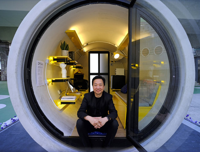 In this Tuesday, March 13, 2018, photo, architect James Law poses during an interview at his OPod tube house in Hong Kong's industrial area of Kwun Tong. Hong Kong's notoriously expensive housing makes owning an affordable home a pipe dream for many residents. But the local architect proposed a novel idea to help alleviate the problem: building stylish micro-apartments inside giant concrete drainage pipes. (Photo by Vincent Yu/AP Photo)
