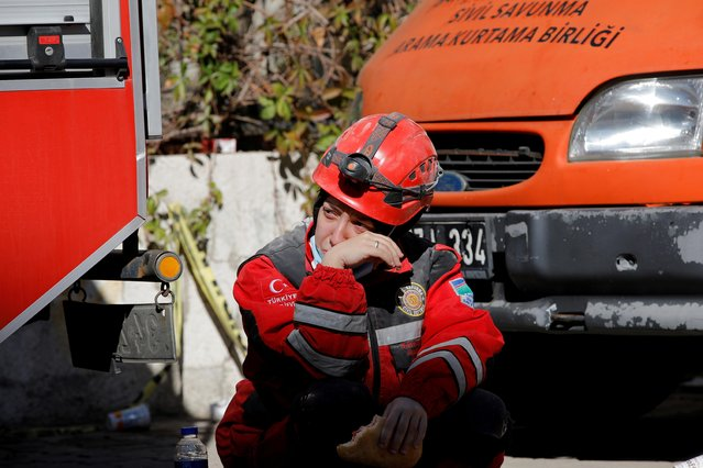 A woman reacts as rescue operations take place on a site after an earthquake struck the Aegean Sea, in the coastal province of Izmir, Turkey, November 2, 2020. (Photo by Kemal Aslan/Reuters)