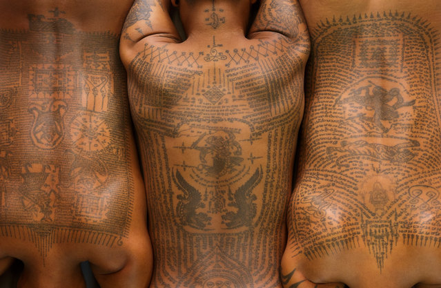 "Traditional Thai tattoo in Bangkok, Thailand. ""These tattoos are the writings of an Indian philosopher. They are thought to protect and bring good luck to the bearer"". (Photo by Art Wolfe/The Guardian)"