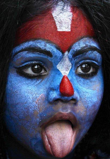 "A young girl dresses as Hindu goddess ""Kali"" as people celebrate ""Gudi Padwa"" or the Marathi new year, in Mumbai, India, on April 11, 2013. (Photo by Rajanish Kakade/Associated Press)"