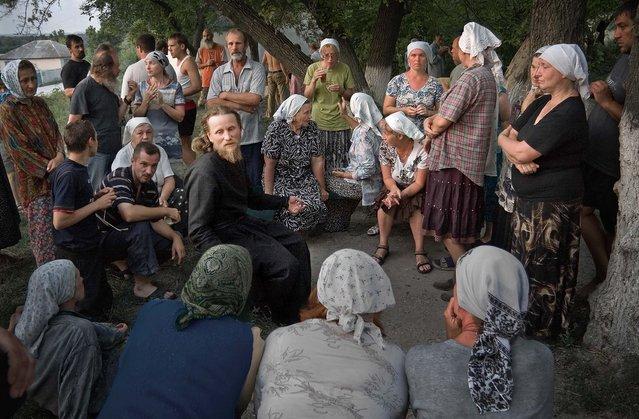 """Conversation with the priest"". (Photo by Sergej Smirnov)"